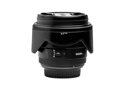 sigma lens with a lens hood for the camera on a white background