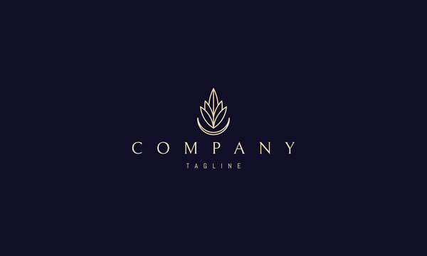 Vector golden logo on which an abstract image of leaves and the moon that form the silhouette of a drop.