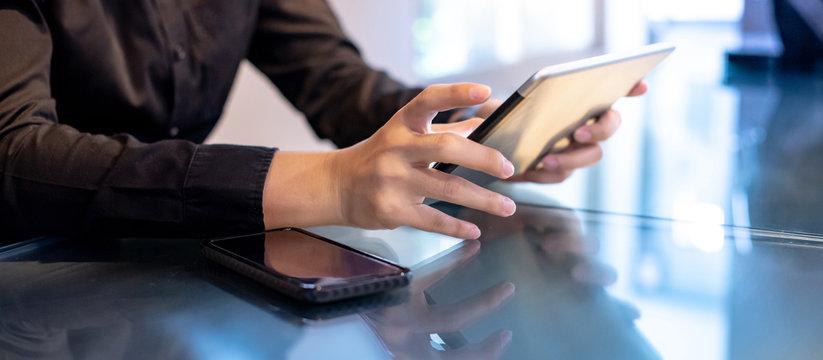 Businessman hand using digital tablet in office meeting room. Male entrepreneur reading news on social media app. Online marketing and Big data technology for E-commerce business.