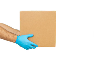 Delivery man holding cardboard boxes in rubber gloves / copy space. Fast and free Delivery transport . Online shopping and Express delivery