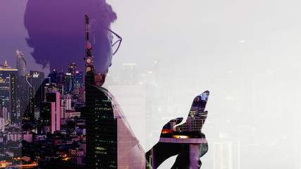 Wall Mural - Double exposure of Asian woman using smart phone and Telecommunication tower with 5G cellular network antenna on smart city background