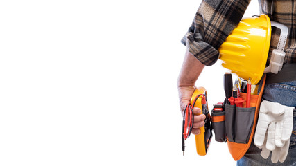 View from behind, electrician holds multimeter tester in hand, helmet with protective goggles. Construction industry, electrical system. Isolated on a white background.