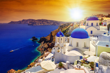 Beautiful sunset over Oia town on Santorini island, Greece