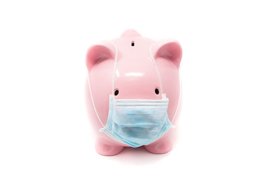 Piggybank wearing surgery mask; concept of the impact of a pandemia in Economy