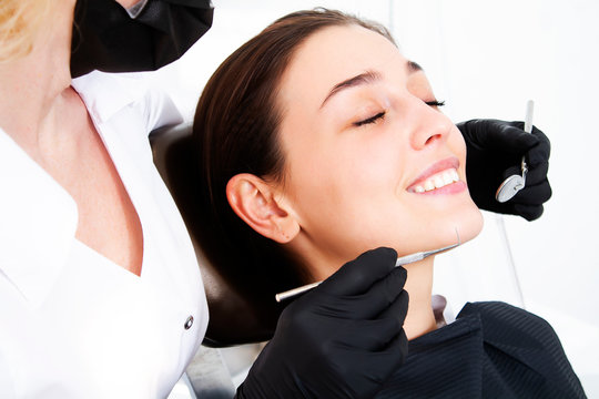 Hygienic toothbrushing. Dental treatment for tooth decay. Dentistry Dentist doctor and patient.