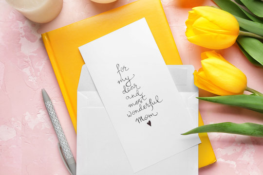 Composition with greeting card for mother on color background