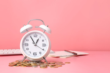 Alarm clock and coins on color background. Time management concept