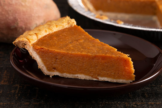 Slice of Sweet Potato Pie Isolated on a Dark Wooden Table