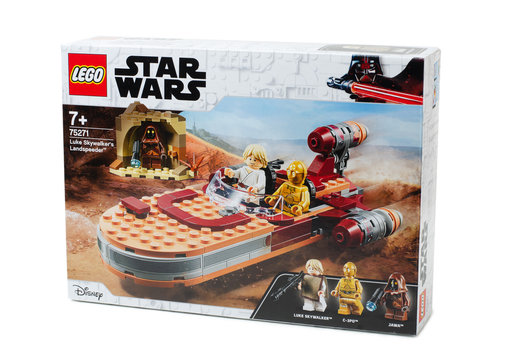 Box of Lego Star Wars - Luke Skywalker's Landspeeder. Famous characters from Star Wars cinematic universe.