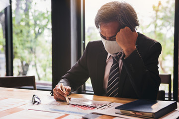 Bad investment or economic crisis from virus concept. Senior businessman with the mask is...