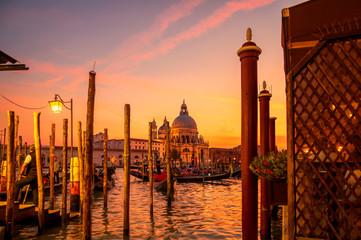 Foto op Aluminium Gondolas Cathedral Santa Maria della Salute and Gondolas in Venice Grand Canal at sunset, Italy. Architecture and landmarks of Venice.