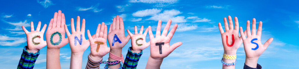 Children Hands Building Colorful Word Contact Us. Blue Sky As Background