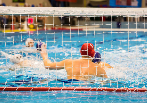 Water-polo match with goalkeeper in gate