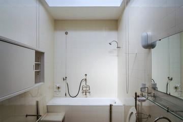 Beautiful shower bath tub in modern functionalism bathroom, white tile design wall