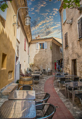 Canvas Prints Narrow alley Tables outside a restaurant in a narrow Eze alley