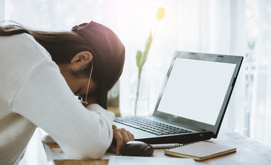 Young asian woman feel tired and sleeping while working or study hard