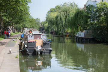 Canal, Pedestrian Path and Boats along the River Bank of Regent's Canal in London