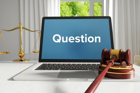 Question – Law, Judgment, Web. Laptop in the office with term on the screen. Hammer, Libra, Lawyer.