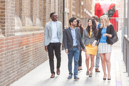Group of young professional walking in the city