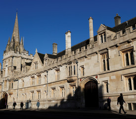 People walk past All Souls College in Oxford