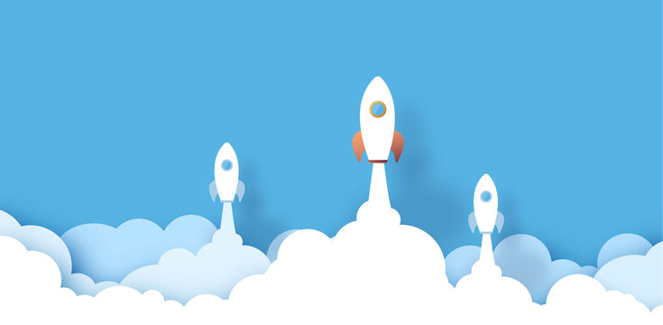 paper spaceship flying across clouds. design paper art and crafts. Rocket leadership startup concept. white clouds on blue sky. Paper cut vector illustration. with space for text.