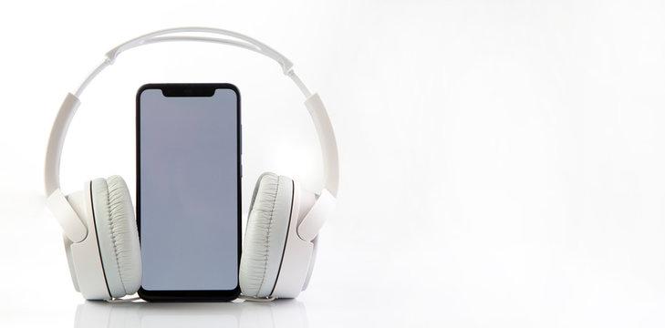 White headphones on smartphone music online concept, mockup, isolate on white