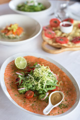 Spoed Foto op Canvas Klaar gerecht Fresh Salmon Carpaccio with Spicy Greens and Lime, Served with Mustard Sauce