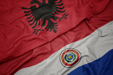 Deurstickers Noord Europa waving colorful flag of paraguay and national flag of albania.