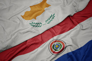 Deurstickers Noord Europa waving colorful flag of paraguay and national flag of cyprus.