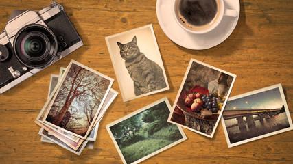 アンティークなカメラと古い写真のあるテーブルトップ