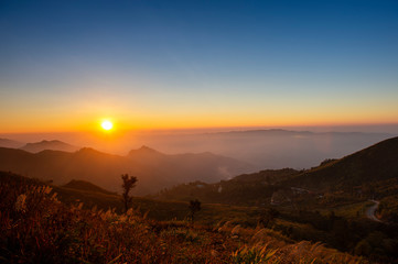 Beautiful Sunset in Pha Thang a beautiful mountain viewpoint for traveler feel like paradise in Chiang rai, Thailand. Asia, Landscape, Nature, mist, background, travel, tourism or trekking concept