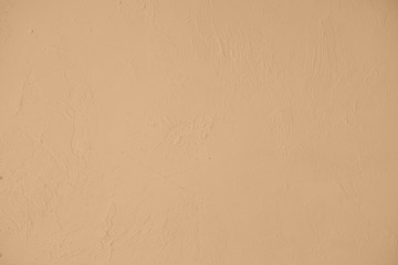 Pale beige colored low contrast Concrete textured background with roughness and irregularities....