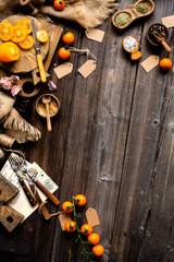 overhead shot of rustic wooden table with food ingredients for cooking (cherry tomatoes, spices, salt), food background