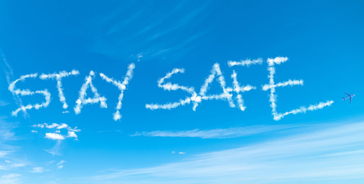 Stay Safe written in the sky with airplane contrails