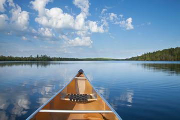 Printed kitchen splashbacks Blue sky Canoe on calm northern Minnesota lake in the morning