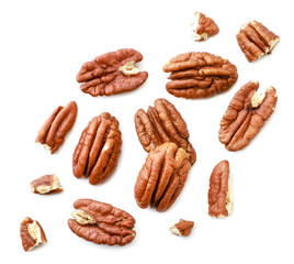 Peeled pecans with broken halves and pieces on a white background. The view from top.