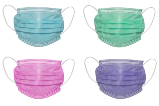 Four surgical masks of different colours, with rubber ear straps. Typical 3-ply surgical mask to cover the mouth and nose. Procedure mask from bacteria. Protection concept.