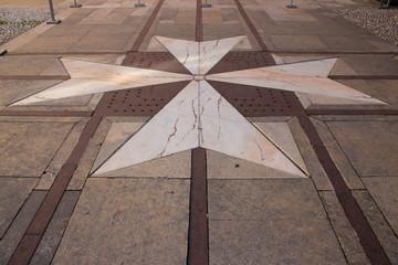 maltese cross on the floor in mdina (malta)