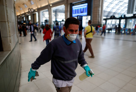A Trenes Argentinos (Argentinian Trains) employee works cleaning the Retiro train station as a preventive measure against the coronavirus outbreak, in Buenos Aires