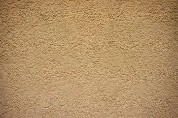 Closeup shot of a beige wall texture - perfect for a cool background