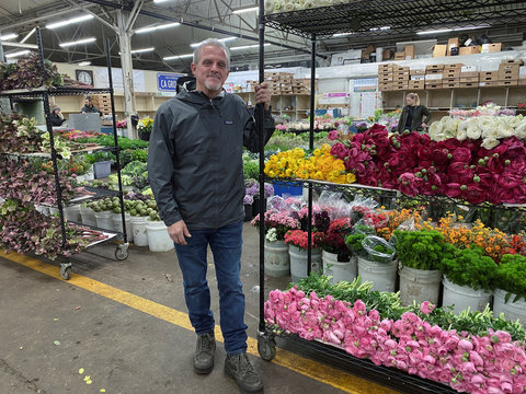 Flower vendor Darrell Torchio stands at San Francisco's wholesale flower market, where business has has been hit hard by bans on large events amid coronavirus (COVID-19) concerns, in San Francisco