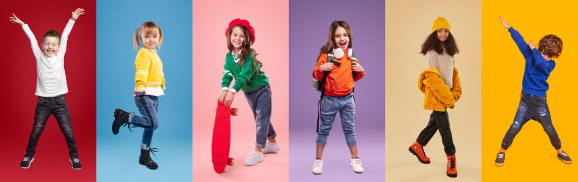 Cheerful multiracial little girls and boys against vibrant background