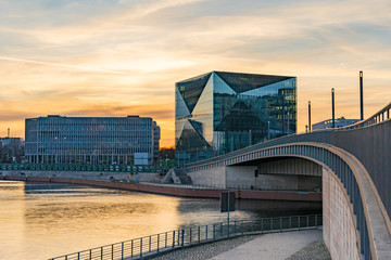 beautiful panoramic view at sunset, Berlin Spreebogen at Hugo-Preuss Bridge with a view of the Cube...