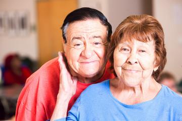 Smiling Hispanic Couple in a Senior Center