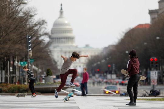 Kids perform skateboard tricks at Freedom Plaza, as Mayor Muriel Bowser declared a State of Emergency due to the coronavirus disease (COVID-19) in Washington
