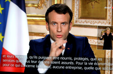 French President Emmanuel Macron is seen addresses the nation about the coronavirus disease (COVID-19) outbreak, on a mobile screen in this illustration picture