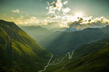 Wall Mural - Evening mood on Furka high mountain pass with beautiful views on Alps