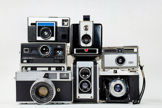 collection of retro cameras on isolated background