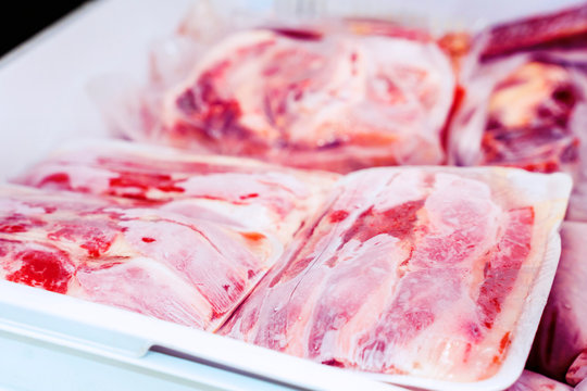 Closeup of plastic wrapped red meat packages