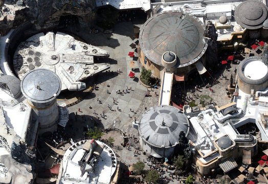 Crowds walk near the Millennium Flacon spaceship inside Star Wars: Galaxy's Edge at Disney's Hollywood Studios on the final day before closing in an effort to combat the spread of coronavirus disease (COVID-19) in Orlando